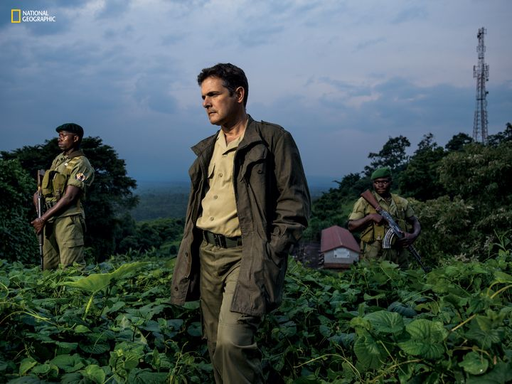 Emmanuel de Merode, flanked by bodyguards at park headquarters nine months after he survived an assassination attempt, has le