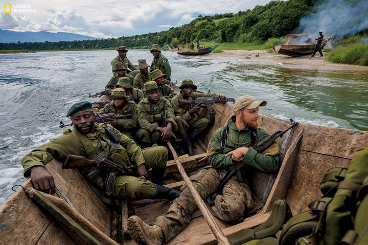 A confiscated boat burns on the beach as rangers, joined by an instructor, try to prevent overfishing on Lake Edward. Fishing