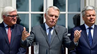 France's Foreign minister Jean-Marc Ayrault (C) speaks flanked by Germany's Foreign minister Frank-Walter Steinmeier (L) and Belgium's Foreign minister Didier Reynders at a press conference after talks at the Villa Borsig in Berlin on June 25, 2016. The EU's founding states said they want Britain to begin leaving the union 'as soon as possible', as France urged a new British prime minister to take office quickly. / AFP / John MACDOUGALL        (Photo credit should read JOHN MACDOUGALL/AFP/Getty Images)