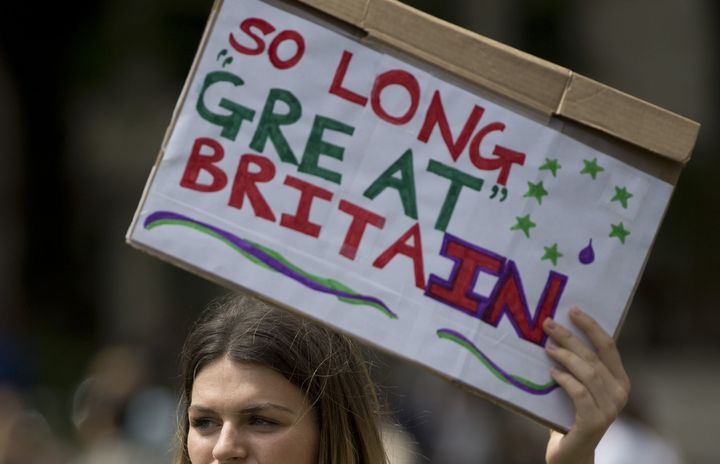 A demonstrator holds a placard reading 'So Long Great Britain' during a protest against the outcome of the UK's June 23 refer