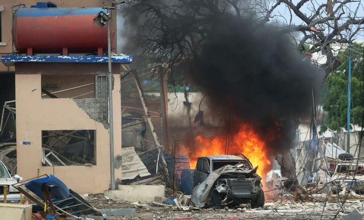 A vehicle burns at the scene of a suicide bomb attack outside Nasahablood hotel in Somalia's capital Mogadishu, June 25, 2016