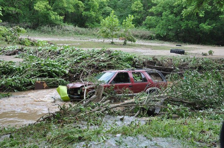 A damaged car is seen after West Virginia was pummeled by up to 10 inches of rain on Thursday.
