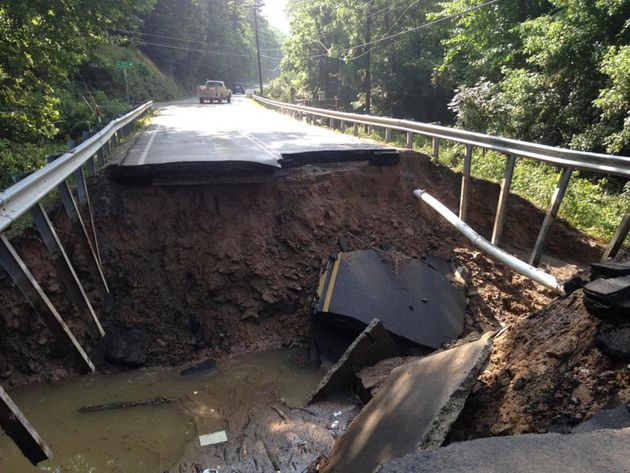 The West Virginia State Highway 4 along the Elk River shows extensive damage after