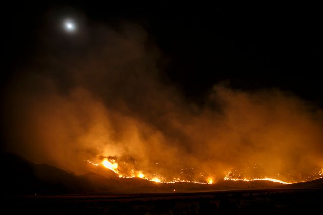 The Erskine wildfire heads down the mountains towards Kelso Valley, near Lake Isabella, Calif., on June...
