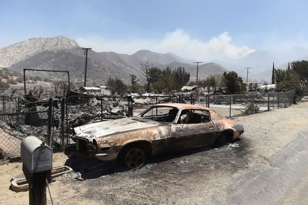 A scorched car sits among leveled homes after the Erskine Fire burned through South Lake, California,...