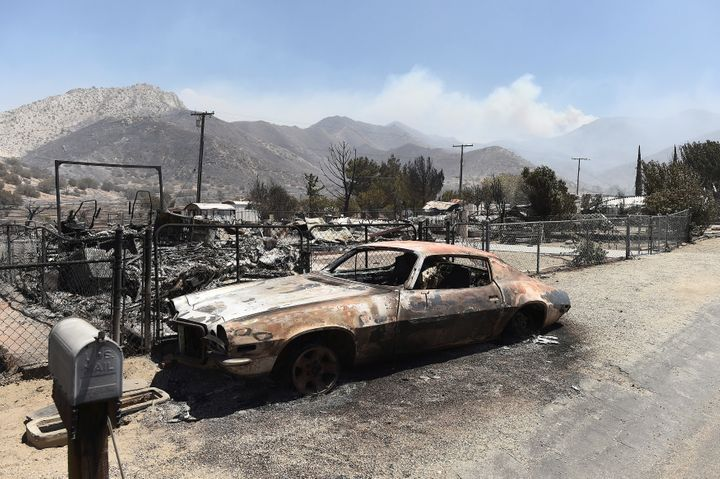 A scorched car sits among leveled homes after the Erskine Fire burned through South Lake, California, U.S. June 24, 2016.