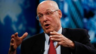Henry 'Hank' Paulson, chairman and founder of the Paulson Institute and former U.S. Treasury secretary, gestures as he speaks during a Bloomberg Television interview in London, U.K., on Monday, May 11, 2015. 'For the U.K. to be economically relevant by far the best case is to be an economic leader in one of the biggest economic blocs in the world,' Paulson said. Photographer: Simon Dawson/Bloomberg via Getty Images **