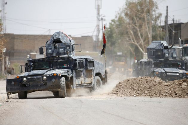Military vehicles of Iraqi security forces are seen in Falluja, Iraq, June 25, 2016. (REUTERS/Thaier