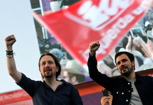Podemos (We Can) leader Pablo Iglesias (L) and Izquierda Unida (United Left) leader Alberto