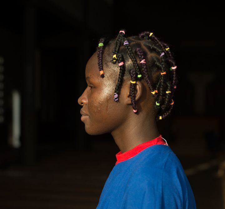 <em>When money is tight, girls will use all the false hair they can collect and from their friends to braid into their own hair.</em>