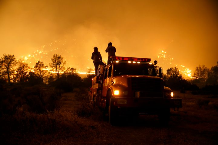Firefighters from Cal Fire's Sonoma-Lake-Napa Unit pay close attention to the wildfire coming at every direction in Kelso Val