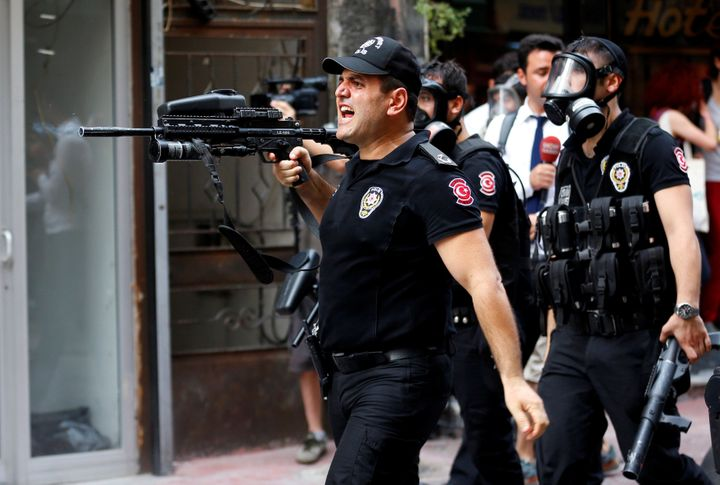 Riot police use rubber pellets to disperse LGBT rights activists as they try to gather for a pride parade, which was banned b