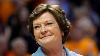 FILE - In this Jan. 28, 2013, file photo, former Tennessee women's basketball coach Pat Summitt smiles as a banner is raised in her honor before the team's NCAA college basketball game against Notre Dame in Knoxville, Tenn. Amid reports of Summitts failing health as her Alzheimers disease progresses, her family issued a statement Sunday, June 26, 2016, asking for prayers and saying that the former Tennessee womens basketball coach is surrounded by the people who mean the most to her. (AP Photo/Wade Payne, File)