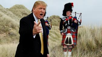U.S. property mogul Donald Trump gestures during a media event on the sand dunes of the Menie estate, the site for Trump's proposed golf resort, near Aberdeen, Scotland, Britain May 27, 2010.  To match Special Report USA-ELECTION/TRUMP-GOLF     REUTERS/David Moir/File Photo