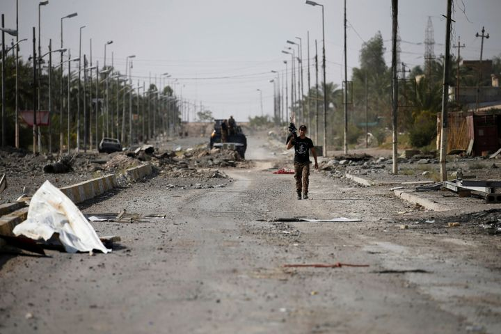 A member of Iraqi counterterrorism forces walks with his weapon in Falluja.