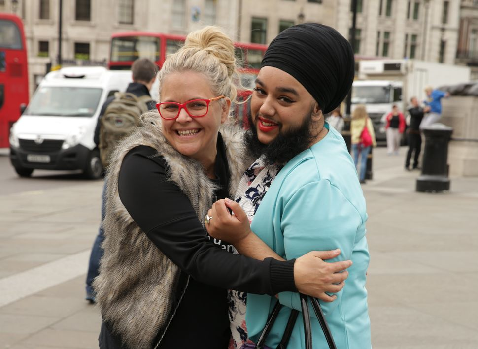 "Taryn Brumfitt hugs Harnaam Kaur in the U.K. Kaur, also known as the ""bearded dame,"" has polycystic ovary syndrome, a co"