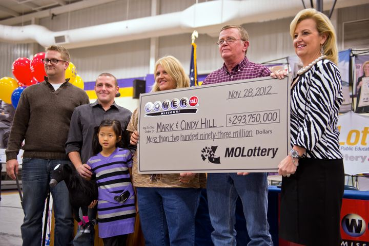 Mark Hill and his wife Cindy, pictured after their jackpot victory, have seen their dreams of building community with their w