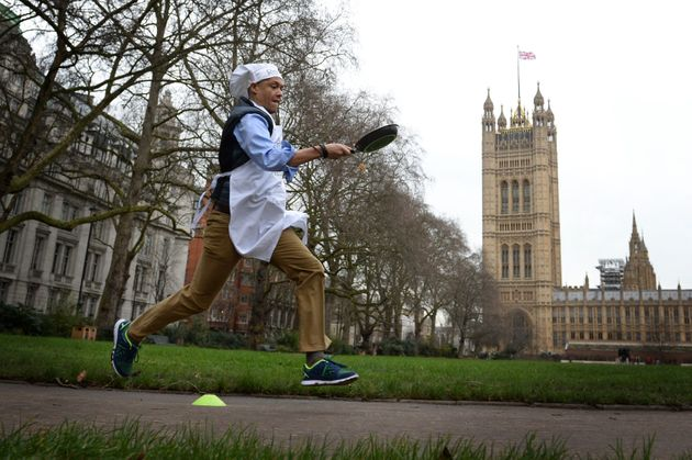 Clive Lewis taking part in the annual pancake day race for