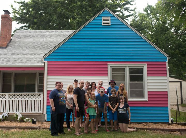 The Planting Peace crew in front of the newest addition to the Equality House compound.