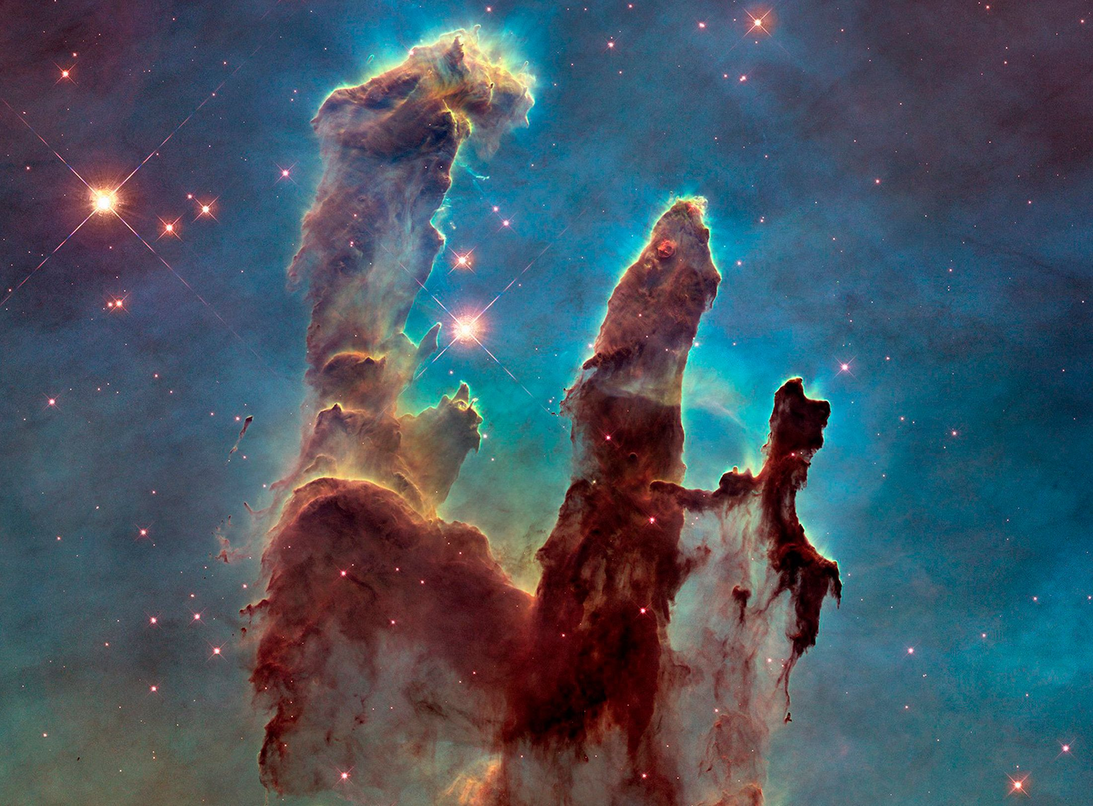 "A Hubble telescope photograph of the iconic Eagle Nebula's ""Pillars of Creation"" is seen in this NASA image released January 6, 2015. By comparing 1995 and 2014 pictures, astronomers noticed a lengthening of a narrow jet-like feature that may have been ejected from a newly forming star. Over the intervening 19 years, this jet has stretched farther into space, across an additional 60 billion miles, at an estimated speed of about 450,000 miles per hour, according to a NASA news release.  REUTERS/NASA/ESA/Hubble Heritage Team/Handout via Reuters   (OUTER SPACE - Tags: SCIENCE TECHNOLOGY) THIS IMAGE HAS BEEN SUPPLIED BY A THIRD PARTY. IT IS DISTRIBUTED, EXACTLY AS RECEIVED BY REUTERS, AS A SERVICE TO CLIENTS. FOR EDITORIAL USE ONLY. NOT FOR SALE FOR MARKETING OR ADVERTISING CAMPAIGNS"