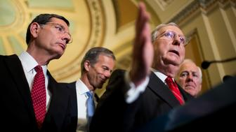 UNITED STATES - JUNE 7: Senate Majority Leader Mitch McConnell (R-KY) speaks to the media following the Senate Republicans' policy lunch in the Capitol on Tuesday, June 7, 2016. McConnell is flanked from left by Sen. John Barrasso (R-WY) Sen. John Thune (R-SD) and Sen. John Cornyn (R-TX). (Photo By Bill Clark/CQ Roll Call)