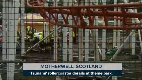 Wreckage from the crash is seen through a fence at the park in Scotland.