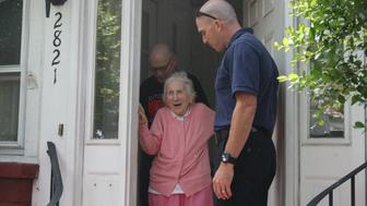 Jeanette Carty is surprised on her 100th birthday with a visit from the City of Norfolk Fire-Rescue.