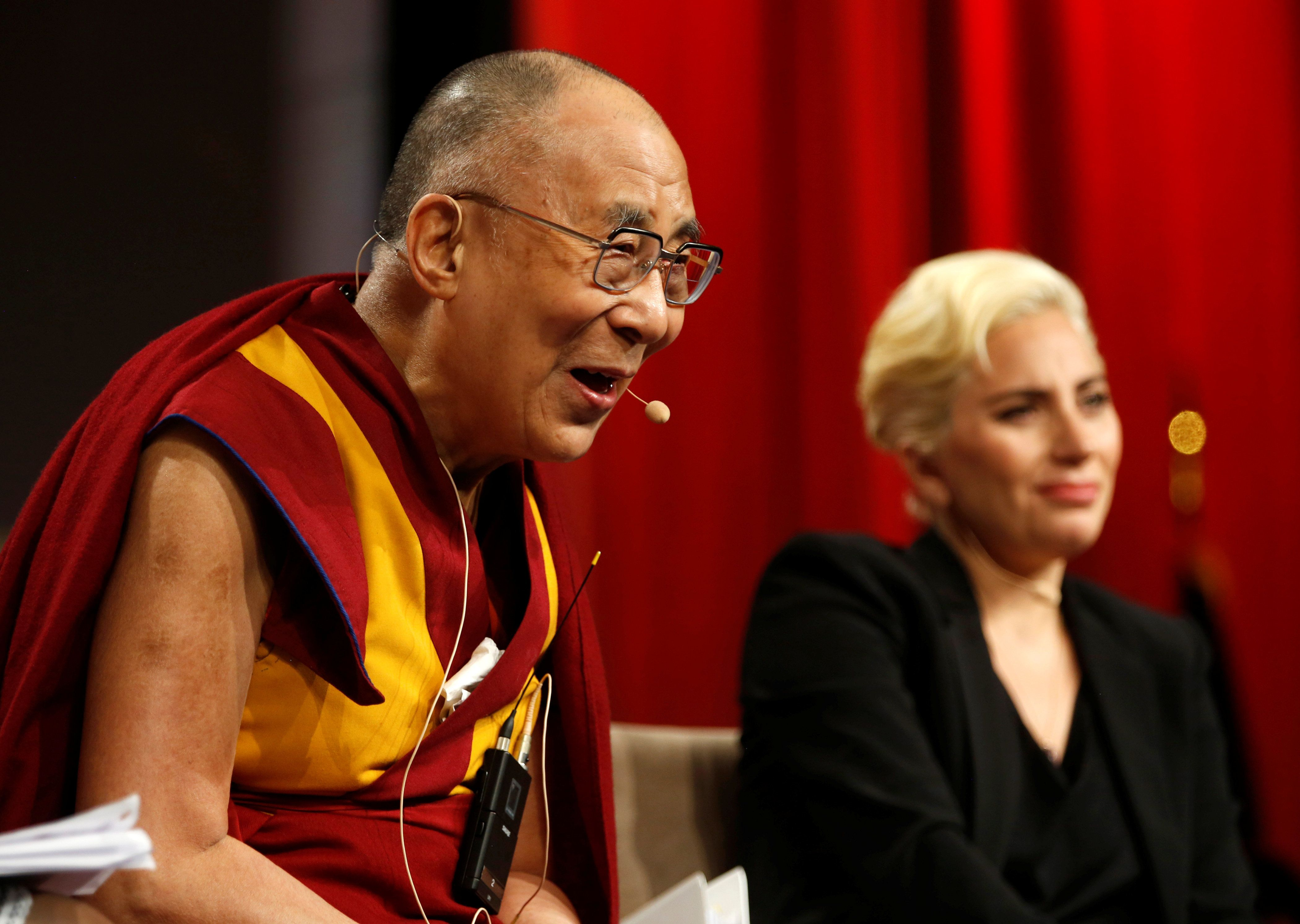 """The Dalai Lama and singer Lady Gaga appear together for a question and answer session on """"the global significance of building"""
