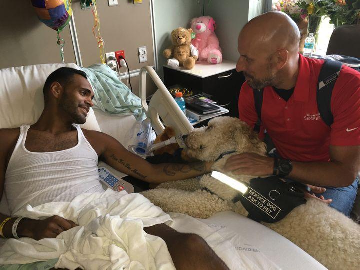 Boston bombing survivor Dave Fortier and his service dog Zealand visitAngel Colon, Pulse shooting survivor is visited i