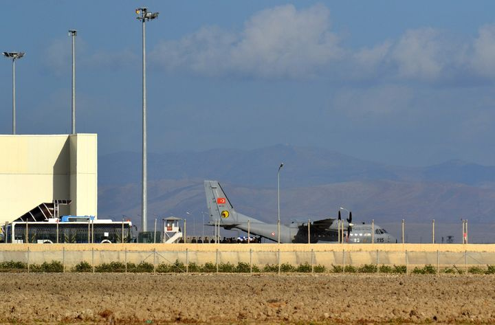 A Turkish cargo plane carries the body of a Russian pilot killed after Turkey downed a Russian fighter jet that Turkish