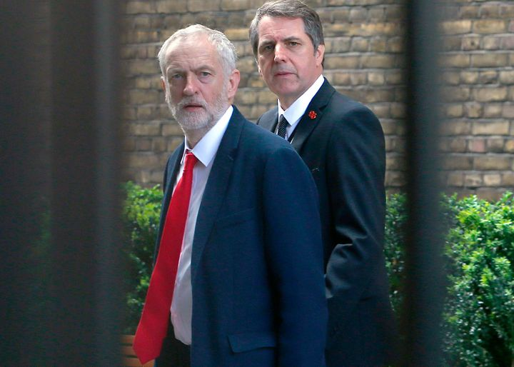 Jeremy Corbyn (L) walks to attend a meeting at the House of Commons. Corbyn has been embattled over the weekend from infighti