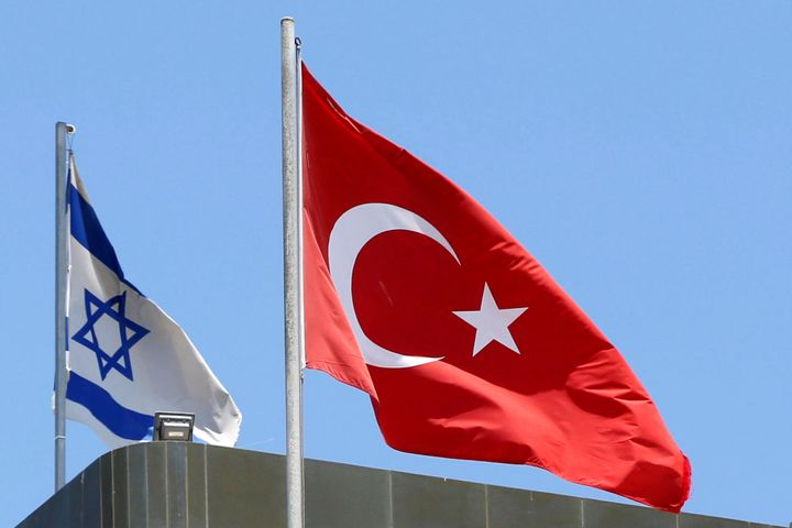 Turkish and Israeli flags on top of the Turkish embassy in Tel Aviv on June 26.
