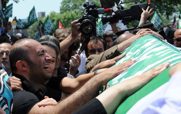 Relatives mourn as the coffin of Cevdet Kiliclar, killed by Israeli forces during a raid on a flotilla carrying aid