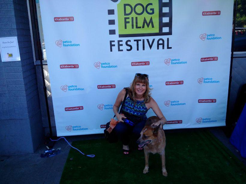 Jill L. Ferguson and Nacho on the green carpet