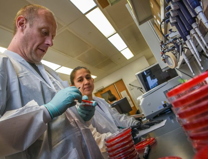 Scientists, likeDr. Patrick McGann, left, and Kathy 'Ana' Ong, have been testing bacteria for the antibiotic-resistant