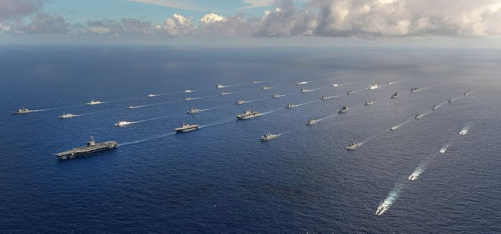 More than 40 ships and submarines representing 15 international partner nations travel in formation during Rim of the Pacific