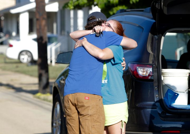 Ami Palmer, 40, hugs her nephew Landon Palmer upon returning to her home in Clendenin, West Virginia, which was damaged by fl