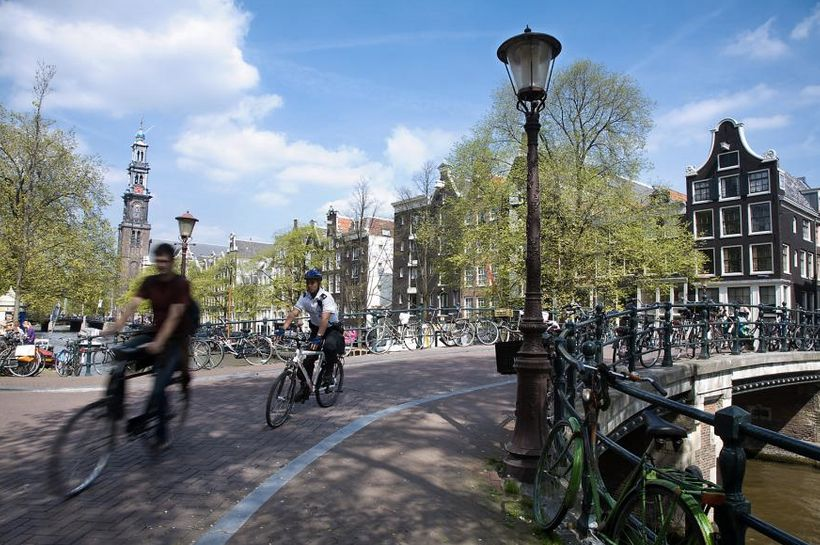 <i>Cyclists crossing one of Amsterdam's many bridges.</i>