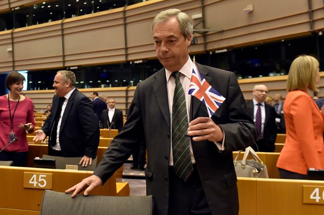 Nigel Farage holds the British flag ahead of his