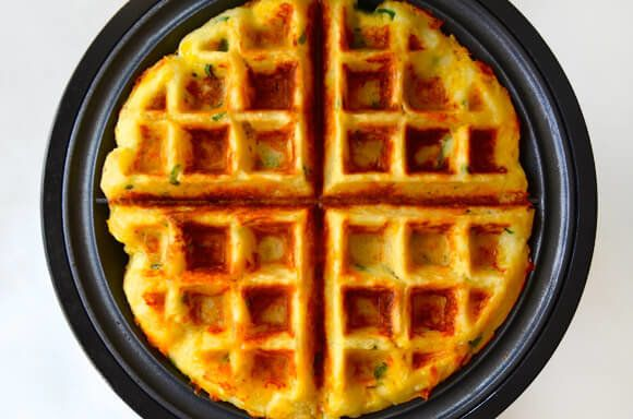 "<strong>Get the <a href=""http://www.justataste.com/cheesy-leftover-mashed-potato-waffles-recipe/"" target=""_blank"">Cheesy Left"