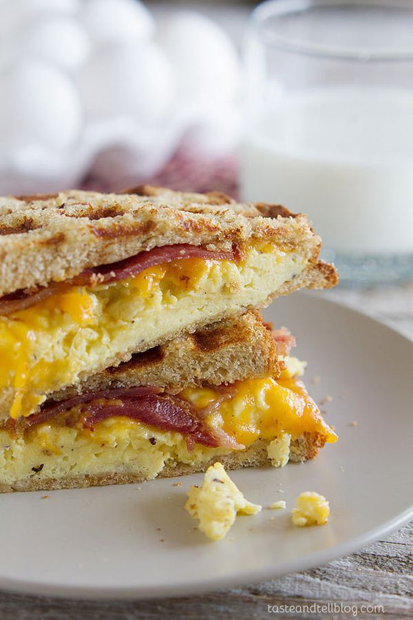 "<strong>Get the <a href=""http://www.tasteandtellblog.com/waffled-breakfast-grilled-cheese-sandwich-recipe/"" target=""_blank"">W"