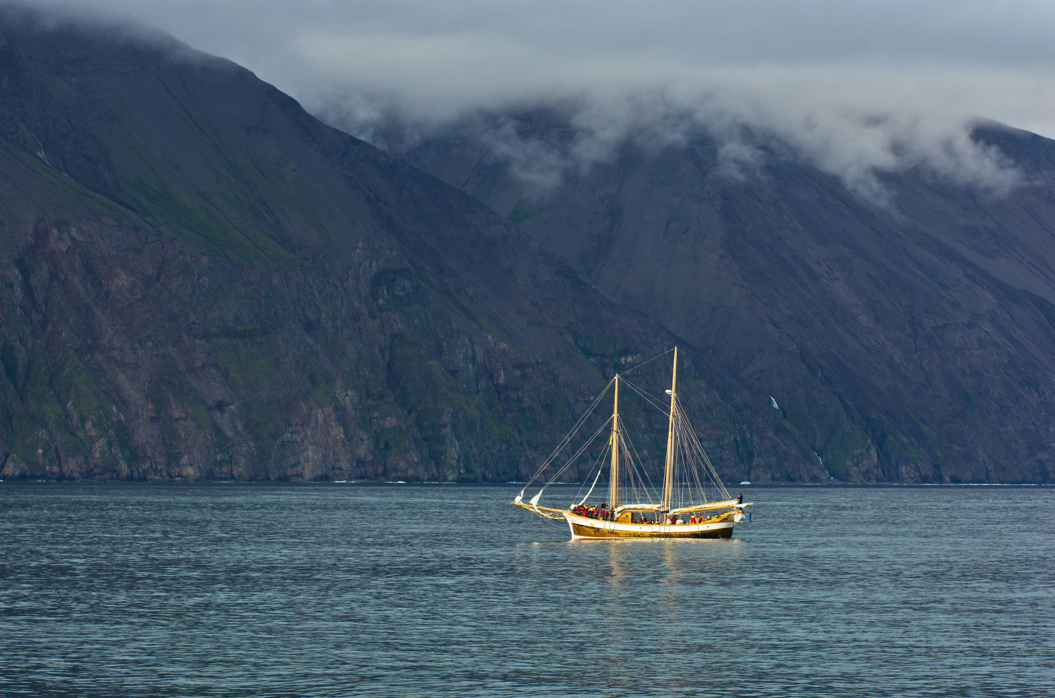 Whale watching tours from old sailing ship at Husavik bay area, north Iceland