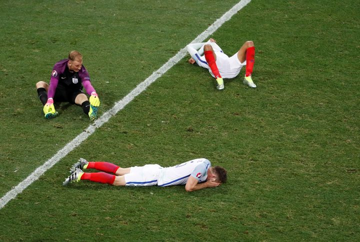 Several of England's soccer players, including goalkeeper Joe Hart (top left), are seen looking dejected after losing to Icel