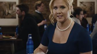 Amy Schumer gets real about the pay gap in her latest Bud Light ad with Seth Rogen