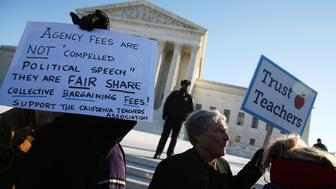 WASHINGTON, DC - JANUARY 11:  People for and against unions hold up signs in front of the US Supreme Court building January 11, 2016 in Washington, DC. The high court is hearing arguments inÊthe Friedrichs v. California Teachers Association case. The case will decide whether California and twenty two other states can make public-employees, such as public school teacher Rebecca Friedrichs, to pay union agency fees.  (Photo by Mark Wilson/Getty Images)