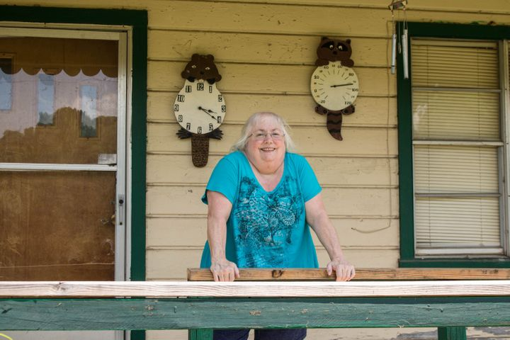 Susan Holmes on the front porch of her home in Bokoshe, Oklahoma.