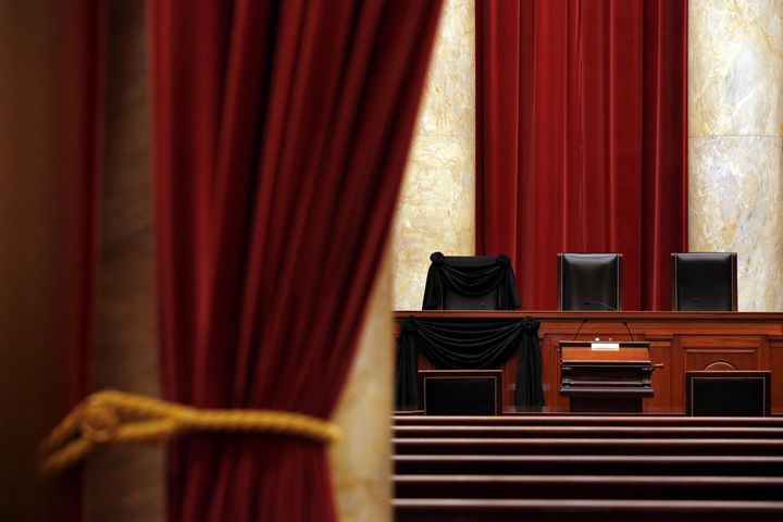 The bench of late Supreme Court Justice Antonin Scalia is seen draped with black wool crepe in memoriam inside the Supreme Co