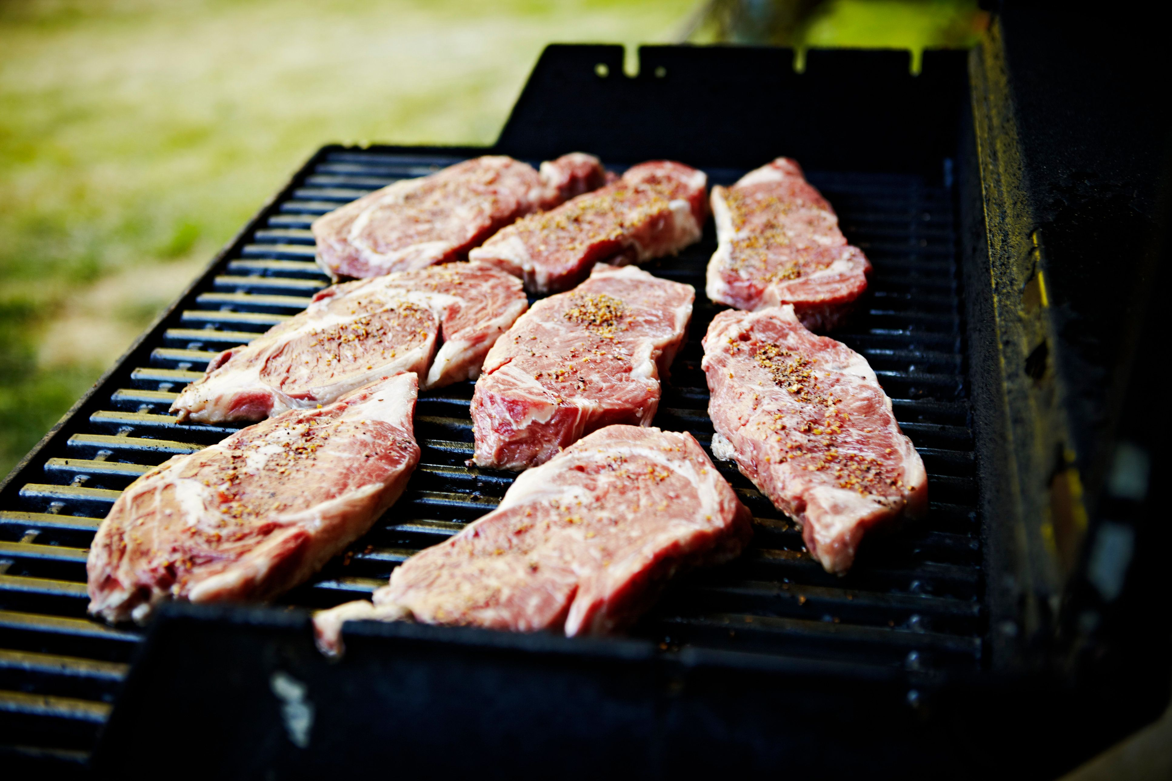 Steaks grilling on barbecue