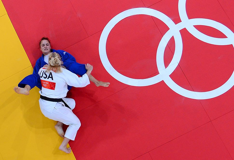 Harrison and Hungary's Abigel Joo compete at the 2012 Olympic Games.