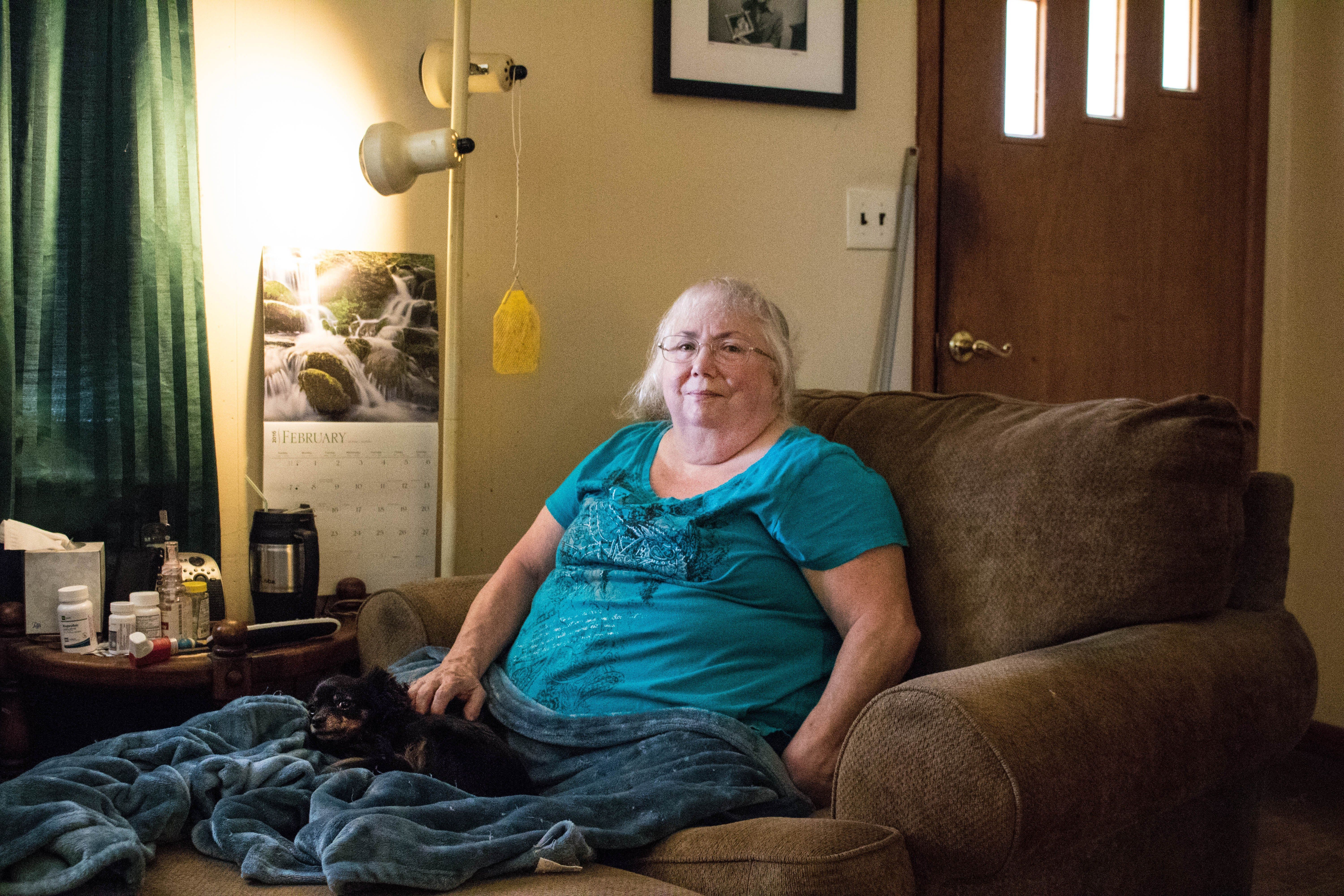 Susan Holmes in the living room of her home in Bokoshe, Oklahoma.